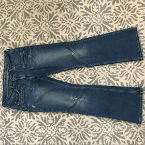 Distressed boot cut jeans